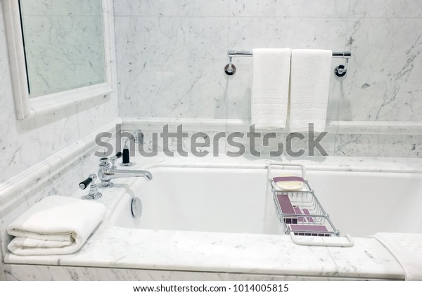 Beautiful bathroom. Details of a sink, a bath and mirror reflections with a flower