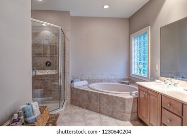 Beautiful bathroom with whirlpool bathtub and separate shower.