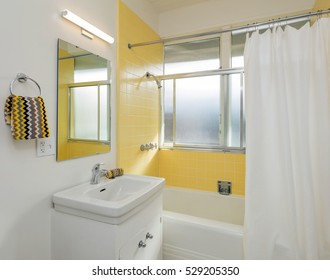 Beautiful Bathroom in white /yellow with shower curtain.
