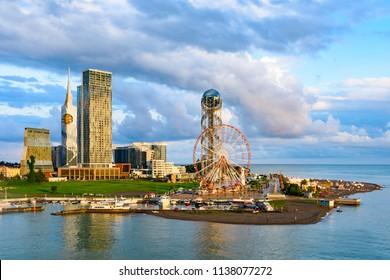 Beautiful Batumi, Georgian resort city and port at Black Sea – panoramic view of city centre from sea in golden summer morning sunlight