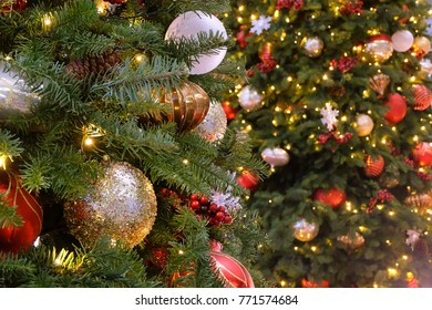 Beautiful bauble hanging from a decorated Christmas tree. Christmas background.