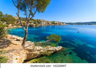 Beautiful bay beach turquoise sea water, Cala Fornells, Majorca island, Spain