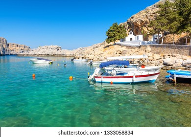 Beautiful bay with greek traditional white chapel in Lindos, Rhodes island, Greece