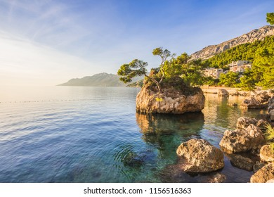 Beautiful bay near Brela town at sunset, Makarska rivera, Dalmatia, Croatia