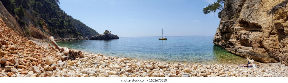 Beautiful bay with a pebbly beach, a yacht in the sea, French Riviera