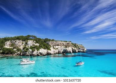 Beautiful bay with sail boats, Menorca island, Spain. Sailing and yachting concept