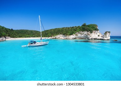 Beautiful bay with sailing boat, Greece. Vacations, travel and active lifestyle concept