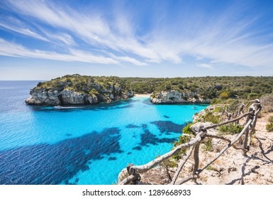 Beautiful bay with sandy beach and sailing boats, Menorca island, Spain