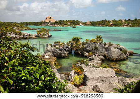 Beautiful bay with turquiose waters & rocky coastline of Xel Ha, Cancun, Mexico