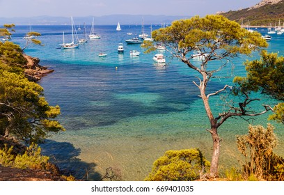 Beautiful bay with yachts in Porquerolles, the island in southern France. Holidays in France.