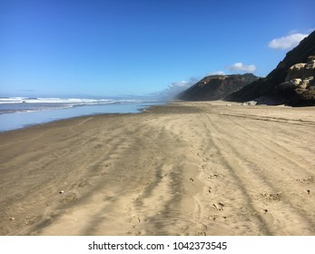 Beautiful Baylys Beach Scenic view on a clear summers day New Zealand