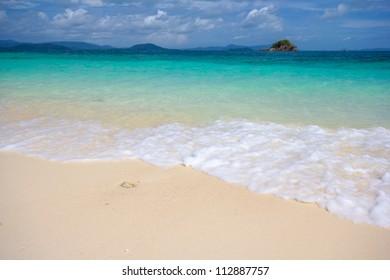 Beautiful beach in Andaman sea against blue sky at Phuket Thailand.