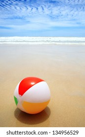Beautiful beach and beach ball on the sand.