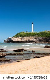Beautiful beach in Biarritz city with the lighthouse in the background. Summer time on the Basque coast of France.