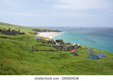 Beautiful beach at Blasket Island with camping tents near Slea Head Drive,  one of Irelands most scenic routes, Dingle peninsula, Kerry, Ireland