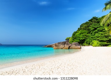 Beautiful beach and blue sky in Similan islands, Thailand. Vacation holidays background wallpaper. View of nice tropical beach.Travel summer holiday background concept.