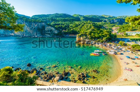 Beautiful beach and boat in Paleokastritsa, Corfu island, Greece