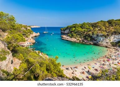 Beautiful beach Cala Llombards at Majorca island with tropic turquoise sea water, Mediterranean Sea Spain.