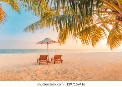 Beautiful beach. Chairs on the sandy beach near the sea. Summer holiday and vacation concept for tourism. Tranquil scenery, relaxing beach, wonderful tropical landscape design. Boost up color process
