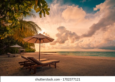 Beautiful beach. Chairs on the sandy beach near the sea. Summer holiday and vacation concept for tourism. Inspirational tropical landscape. Tranquil scenery, relaxing beach, tropical landscape design - Shutterstock ID 1702377121