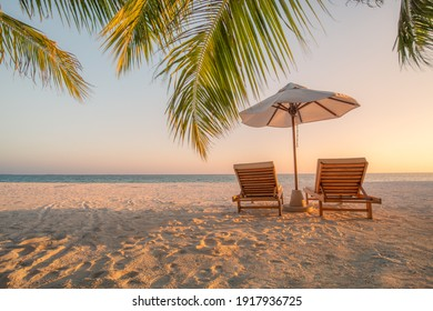 Beautiful beach. Chairs on the sandy beach near the sea. Summer holiday and vacation concept for tourism. Inspirational tropical landscape. Tranquil scenery, relaxing beach, tropical landscape design - Shutterstock ID 1917936725