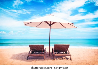 Beautiful beach. Chairs on the  sandy beach near the sea. Summer holiday and vacation concept. Tropical beach.
