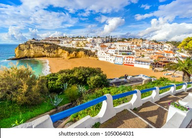 Beautiful beach, cliffs and stairs in colorful Carvoeiro, Algarve, Portugal