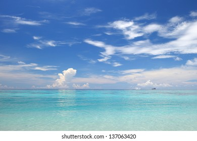 Beautiful beach with crystal clear blue waters of the Andaman sea against blue sky ,Thailand.