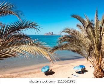 Beautiful beach in El Portet, with Penyon de Ifach in background, Alicante, Spain.