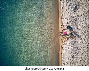 Beautiful beach with family top aerial view drone shot, Sithonia, Greece