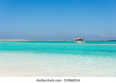 Beautiful beach with fishing boat in the Caribbean Sea, on a sunny day. La Tortuga (Turtle) island, Venezuela.