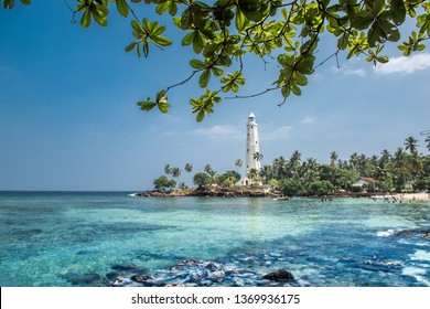 Beautiful beach and light house in Sri Lanka
