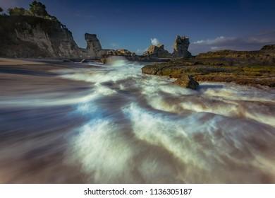 Beautiful beach in long exposure shot photography; Java, Indonesia