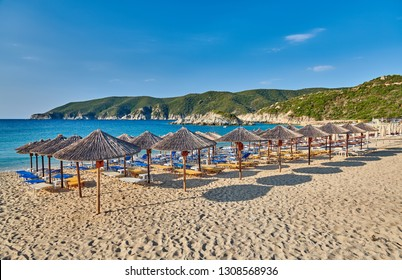 Beautiful beach with loungers and umbrellas at Sithonia, Greece