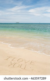 beautiful beach with i love you note on sand