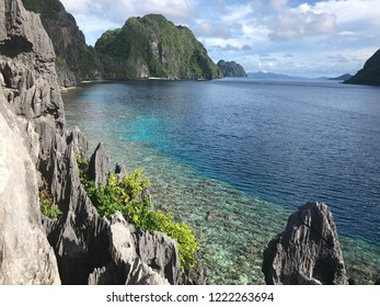 Beautiful beach in Matinloc Island El Nido Palawan Philipines just only a few steps up to the hill near the Shrine then you will find clear blue water with many corals