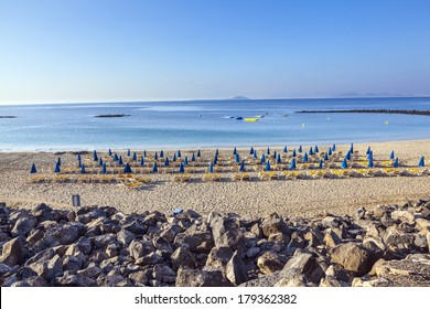 beautiful beach in the morning with beach beds and umbrella