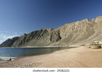 Beautiful Beach with mountains on one side and the ocean on the other