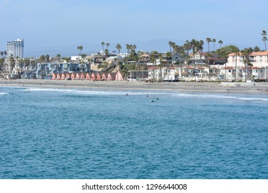 The beautiful beach in Oceanside California on a March day with small waves on the ocean.
