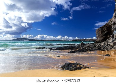 Beautiful beach on the island of Lanzarote in the village Playa Blanca. Sandy beach surrounded by volcanic mountains / Atlantic Ocean and wonderful Papagayo beach. Lanzarote. Canary Islands