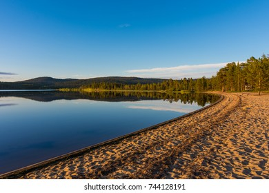 Beautiful beach on the shore of Inari Lake during the midnight sun, finland