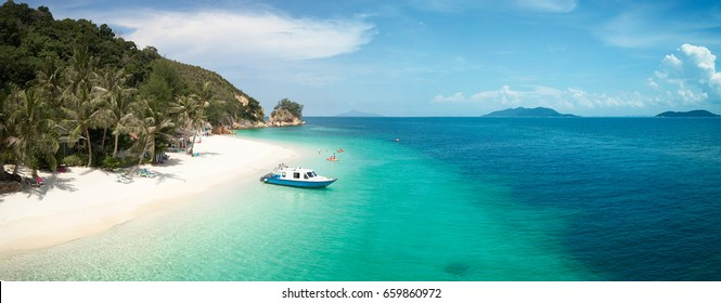Beautiful beach panorama view over a Rawa island. White sandy beach seen from above. Malaysia .