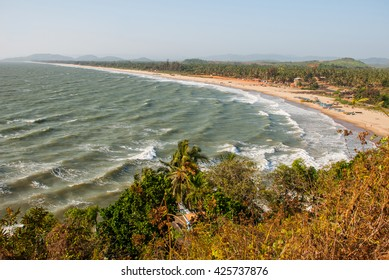 Beautiful beach with rocks and blue sea. Gokarna, Karnataka, India