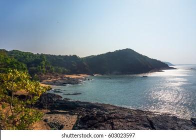 Beautiful beach with rocks and blue sea. Om beach, Gokarna, Karnataka, India