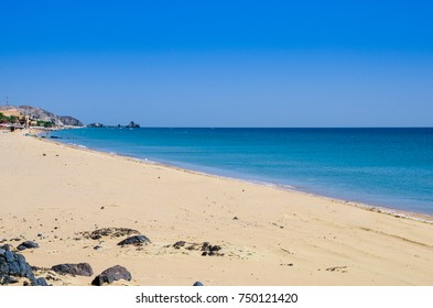 Beautiful beach with rocky hills around it,the sea is very blue and clean.