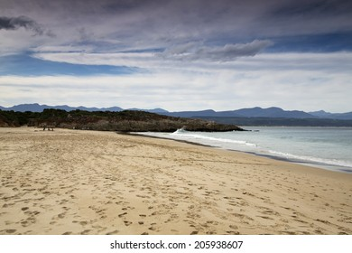 A beautiful beach scene on an overcast afternoon in Plettenberg Bay, South Africa