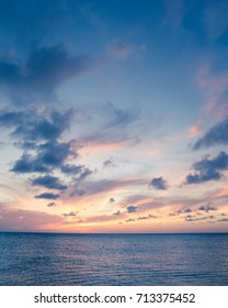 Beautiful beach scene with  sea and sunset sky
