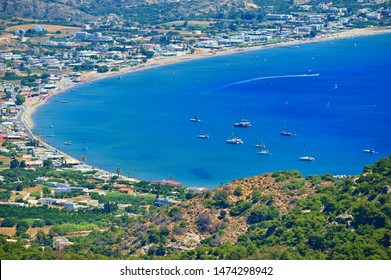 Beautiful beach with sea in tourist resort. Greece island Kos. Beautiful concept for summer vacation. Natural colorful background.