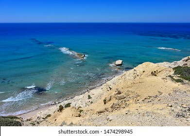 Beautiful beach with sea in tourist resort. Paradise beach in Greece island Kos - Kefalos. Summer concept for vacation/holiday. Natural colorful background.