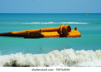 Beautiful Beach Seascape with Floating Pipe in Backdrop.